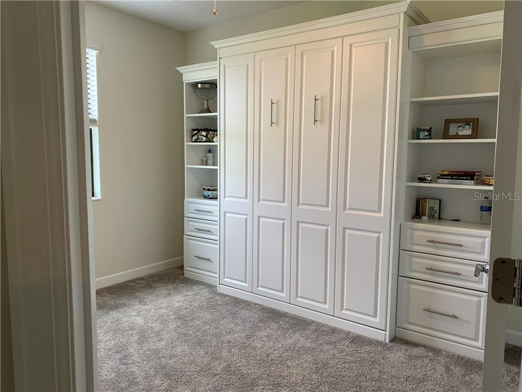 Custom Murphy bed folds into cabinetry ??? how cool is this!