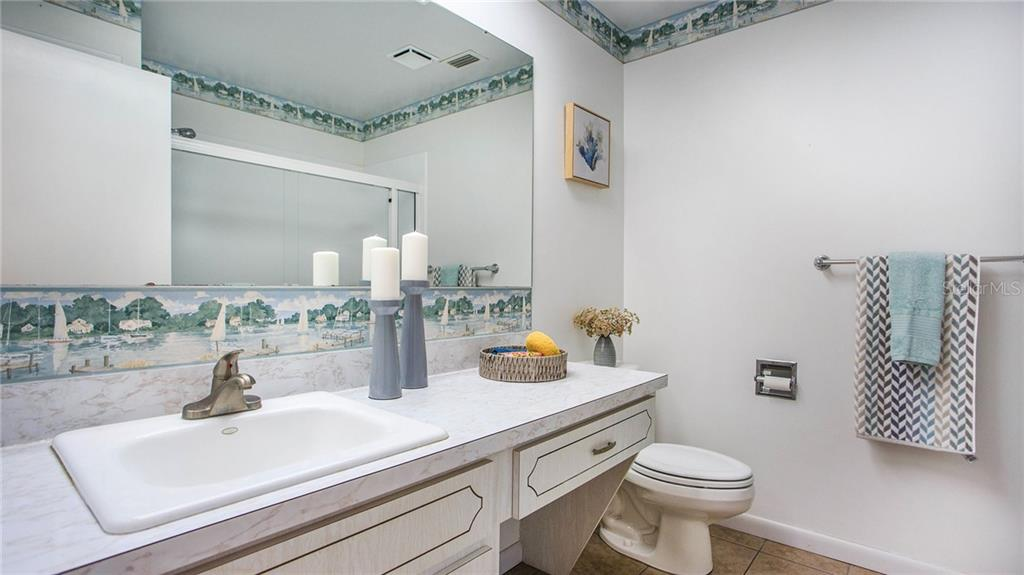 Guest bath, located off the main hallway, has shower/tub combination and a large linen closet.