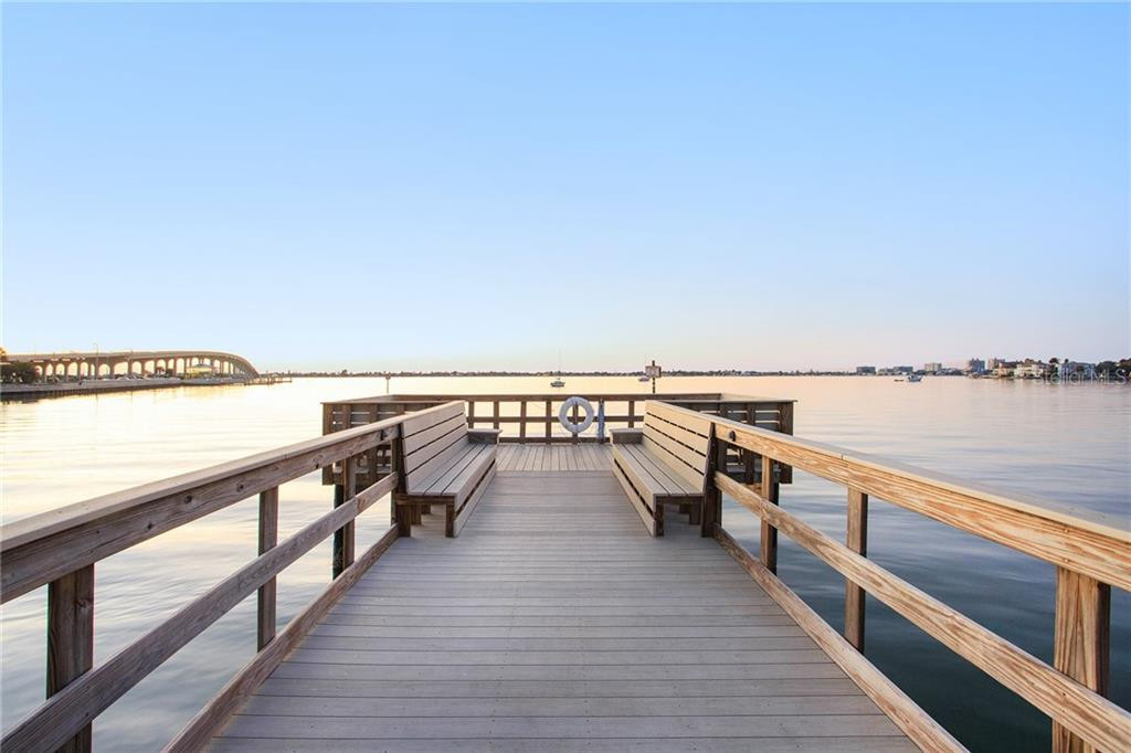 Relax on the community\'s private fishing pier while enjoying views of sunsets, sailboats, dolphins and an expansive water view!
