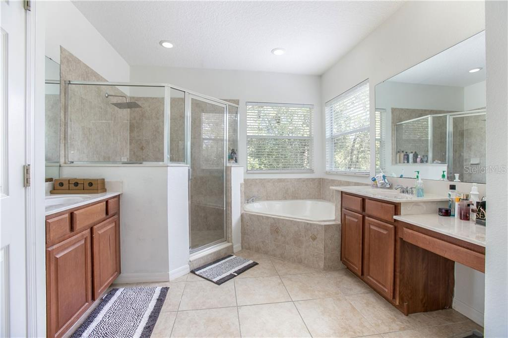 Master bath features walk-in closets, garden tub, water closet and dual sinks.