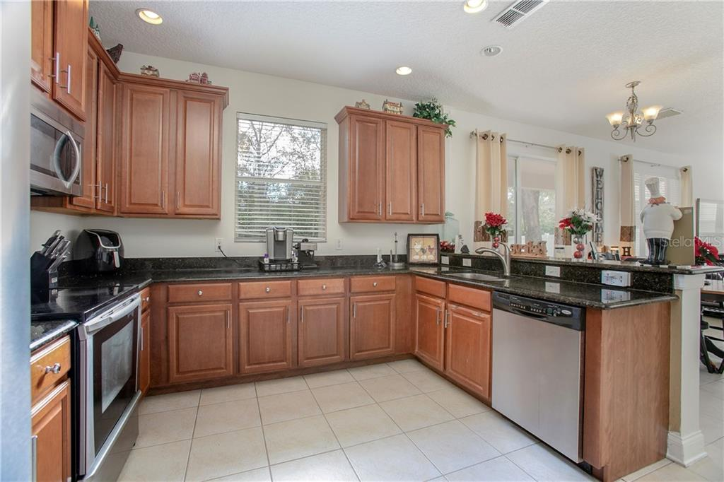 Beautiful Kitchen w/ 42 inch cabinets and stone counter tops.