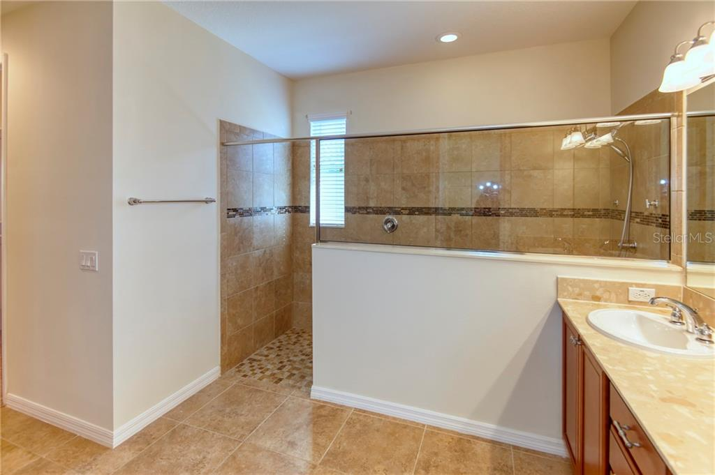 Here\'s the entry.....custom wall tile matches the floor tile