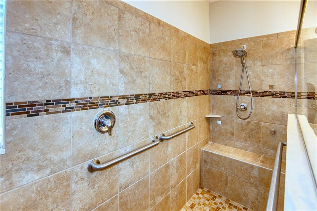 For a true \'spa-like experience\', the Owner\'s Suite shower has optional full body jets! Check out the beautiful contrasting listello inlay