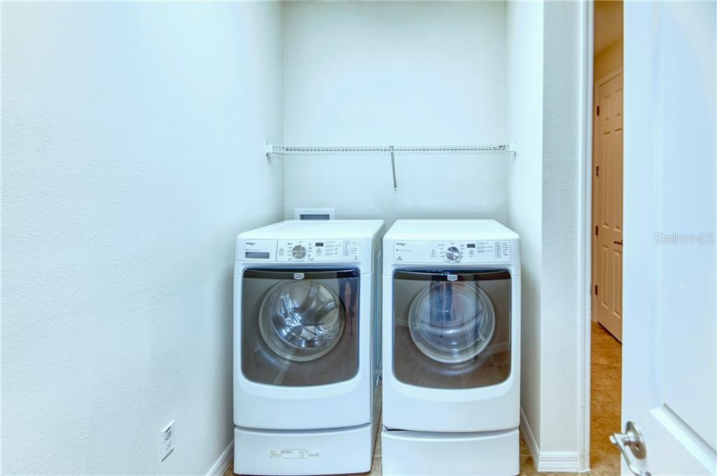 A unique feature in this home - walk directly from the Owner\'s bath into the laundry room! Makes wash day a breeze!