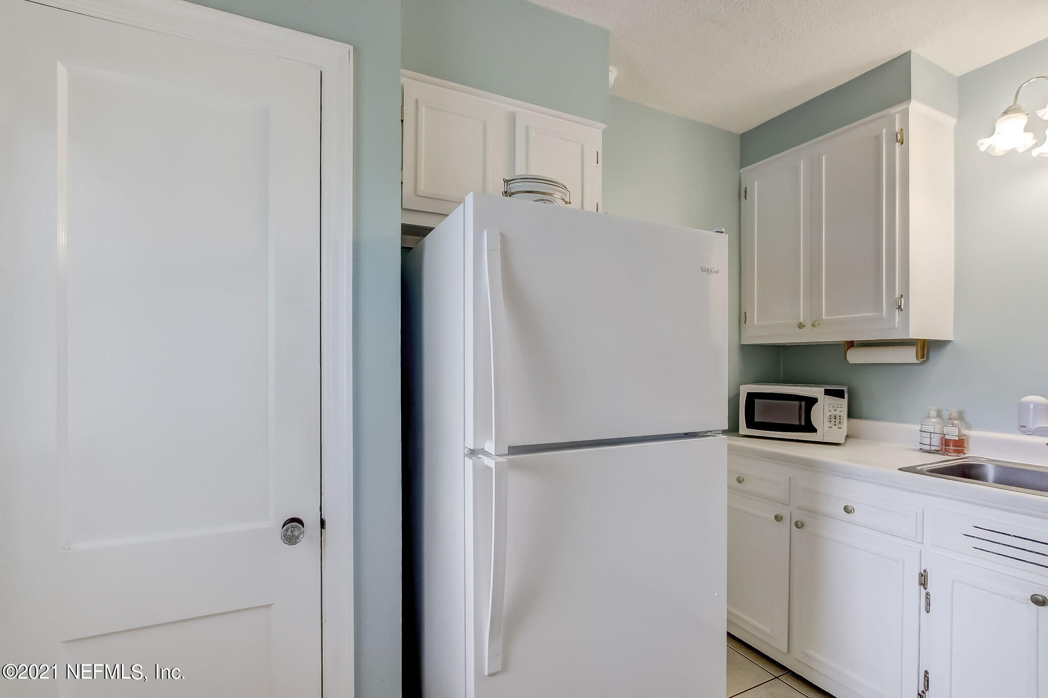Kitchen View with new Whirlpool Refriger