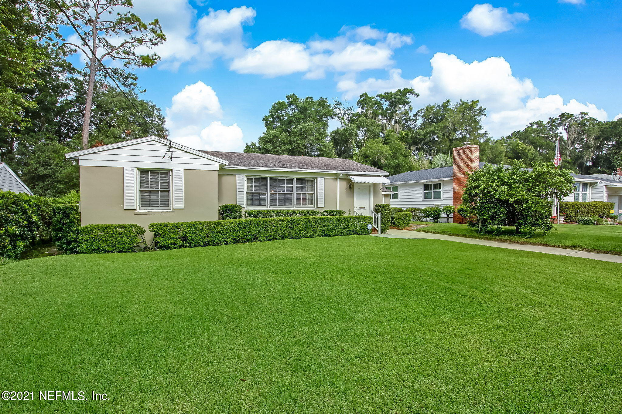 Exterior Front with lush green grass wit