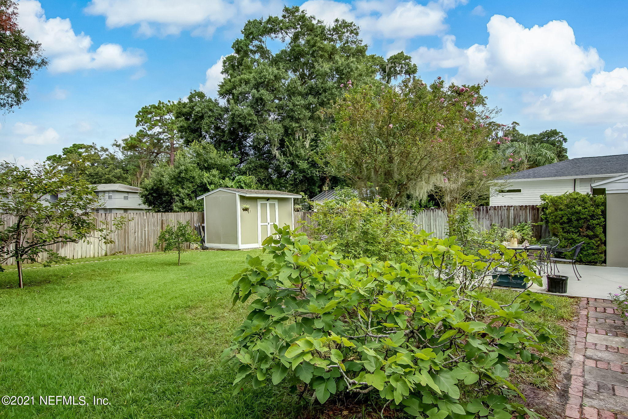 Private Fenced Backyard with Storage She