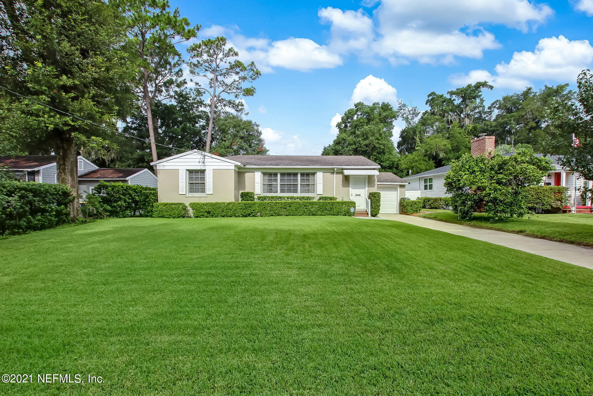 Exterior Front with lush green grass and