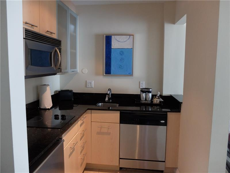 Don\'t Feel Like Cooking, no Problem Call for Room Service have your food and drinks brought up! Spacious Kitchen has All You and or your Guests need as Home Way From Home.