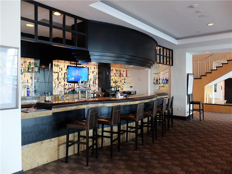Craving your Favorite Adult Beverage but don\'t feel like Driving? No Problem, Check out the Bar on the Lobby overlooking the Intracoastal and Pool! Enjoy while watching the boats going by. You will love it here whether you are here full time, part time or your part of the hotels daily rental program!