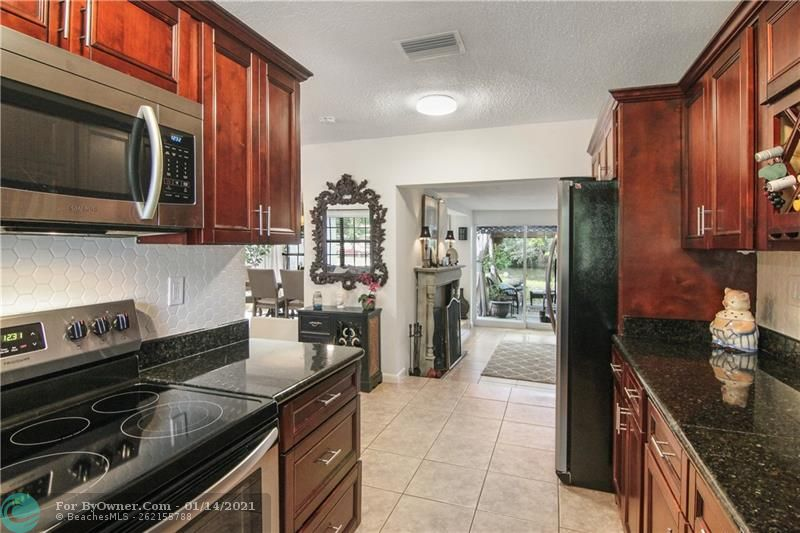 Kitchen is Crisp with Granite Counter Tops