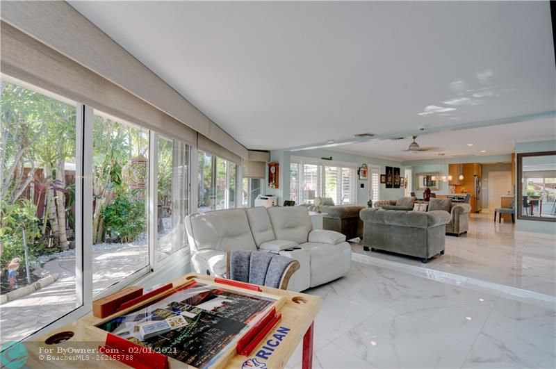30x30 porcelain tile throughout, plantation shutters and sun shades throughout
