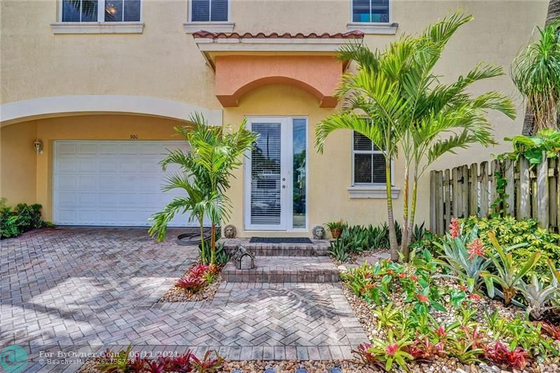 Welcome home and welcome your guests to a beautifully landscaped entrance in this spacious Tarpon River residence.
