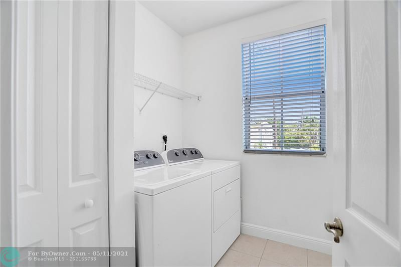 Very nice size laundry with great storage on the second floor where all your dirty clothes and laundry are!!!
