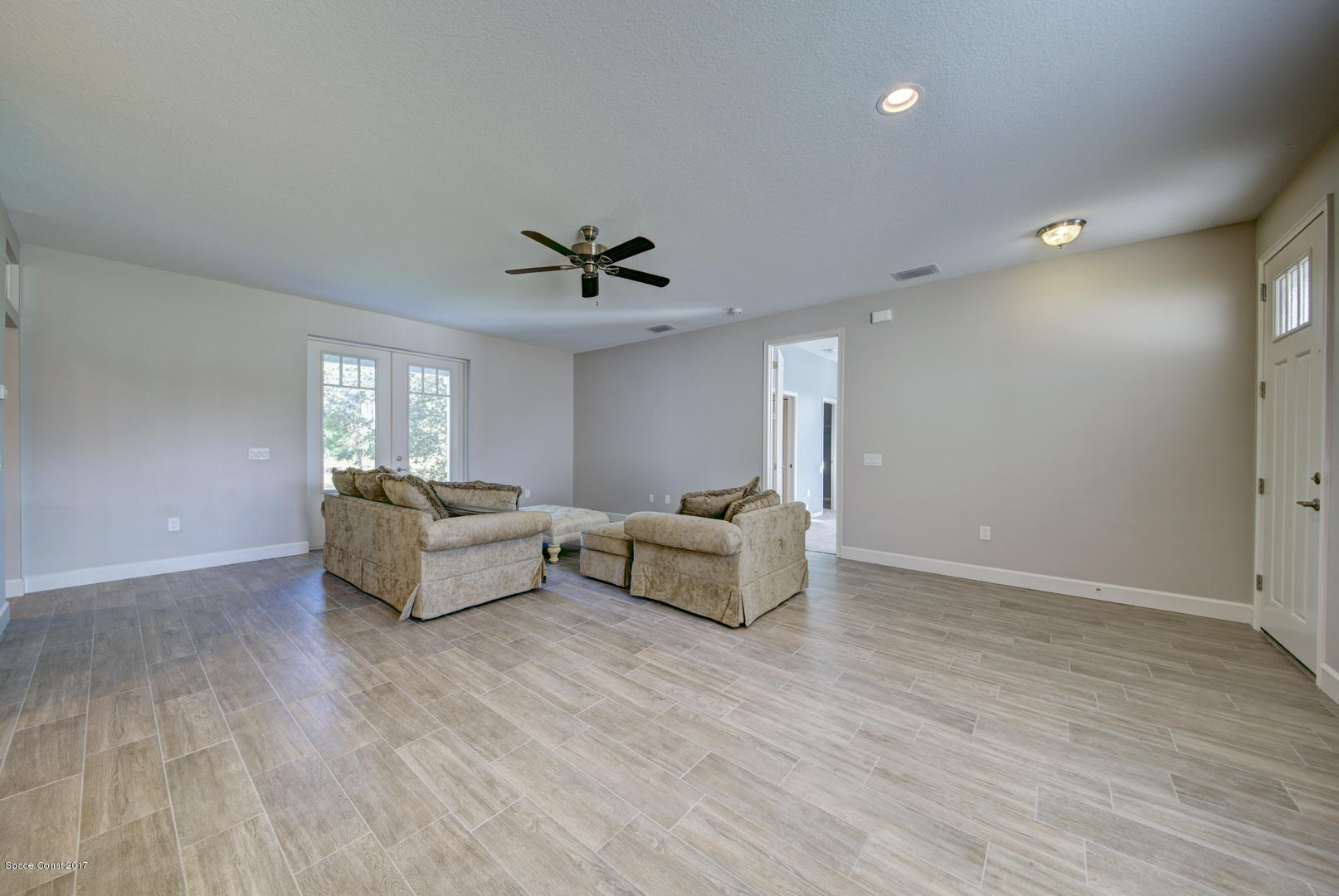 Living Area with French Doors to Patio